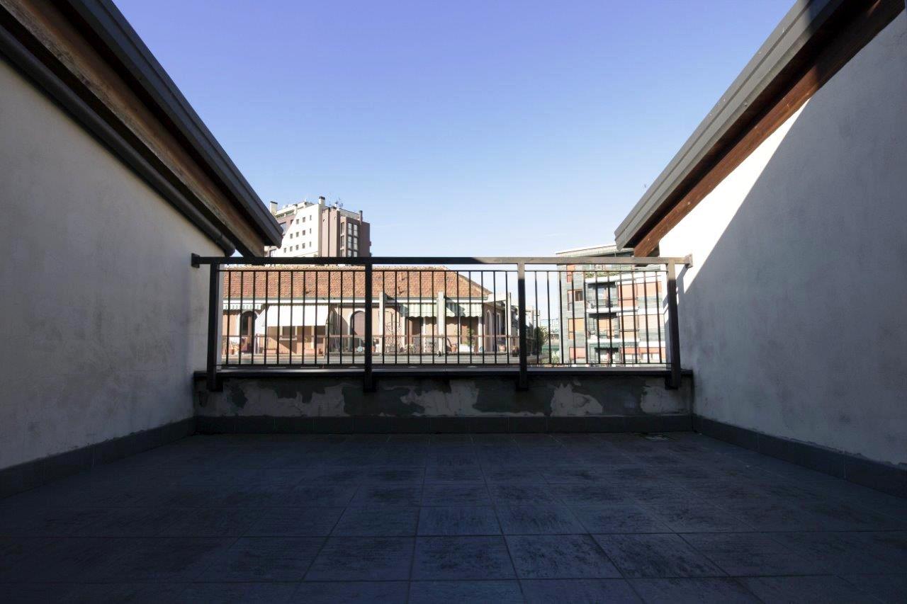 City Life: attico con terrazzino e posto auto